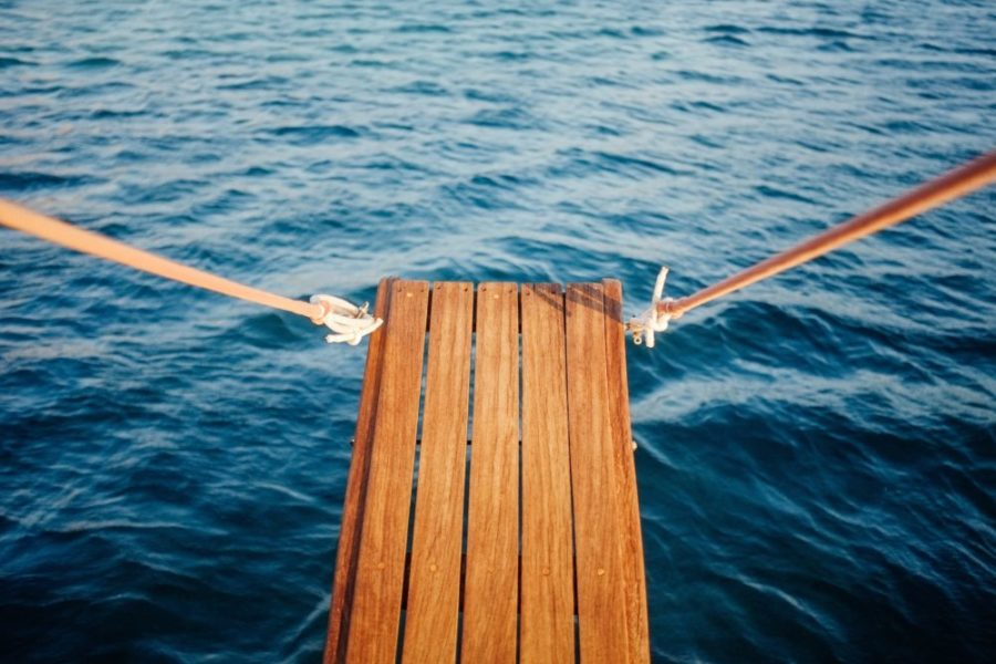 Wooden plank on a boat over the water