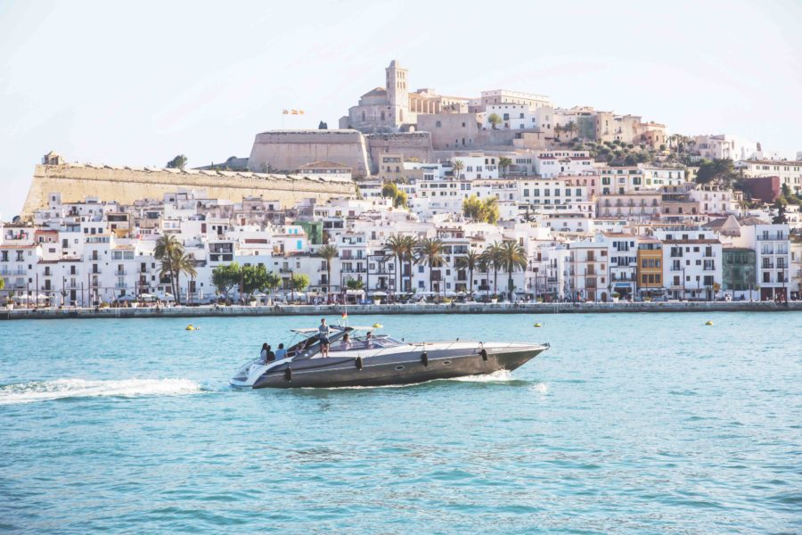 Luxury boat speeding by the coast of Ibiza